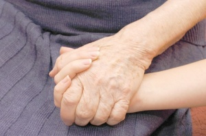 Old young holding hands seated