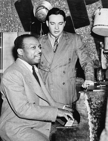 Count Basie at the piano with vocalist Bob Crosby, ca. 1941