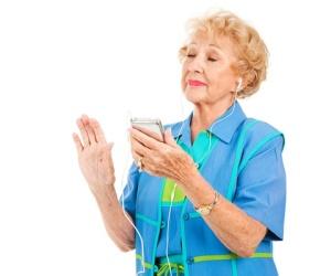 Senior Lady Listens to Music