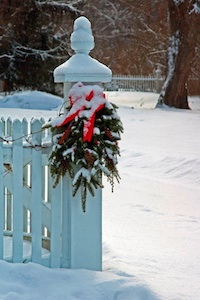 Wreath on fence in snow