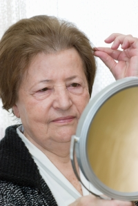 Old woman looking in mirror